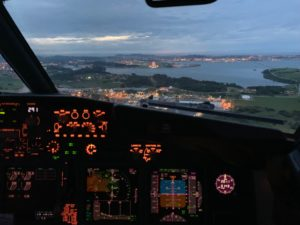 Aircraft coming into Santander, showing marina Cantabrico to right of runway and City beyond.